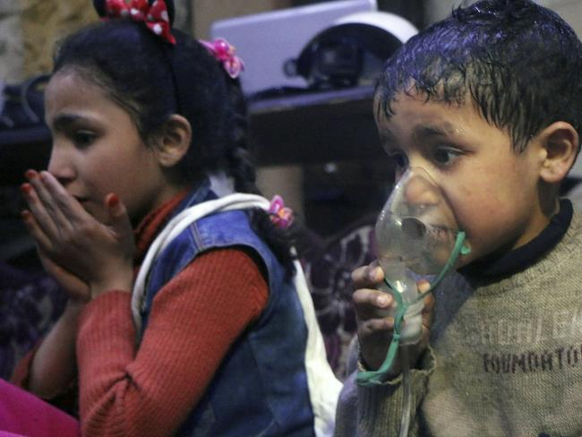 A child receives oxygen through respirators following an alleged poison gas attack in the rebel-held town of Douma, near Damascus, Syria. Picture: AP