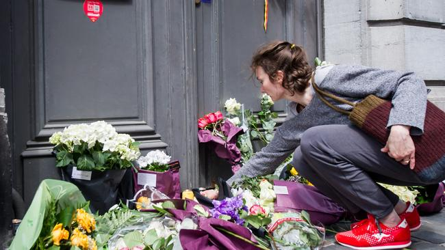 Memorial ... mourners leave notes and flowers at the Jewish Museum in Brussels where three people were killed. Picture: AFP