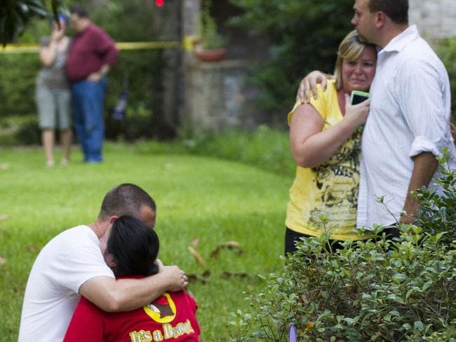 Neighbours in distress ... following the shooting. Picture: AP Photo/Houston Chronicle, Brett Coomer