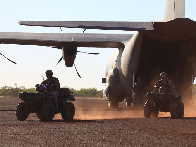 "Mobile force ... Soldiers unload All Terrain Vehicles from a C-130J Hercules during Exercise Pitch Black 2014. SAS soldiers will likely be deployed while RAAF transports sit on airfields in Iraq's ""Combat Zones"". Source: Defence"