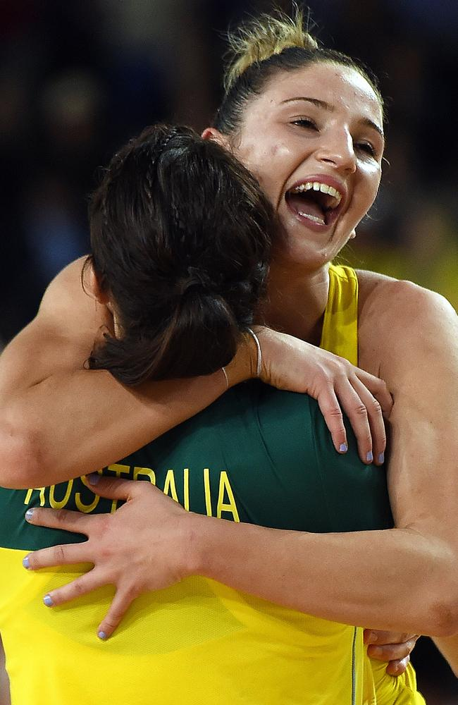 Australia's Kimberley Ravaillion (R) embraces a teammate as Australia wins netball gold.