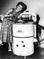 How we washed our clothes in the 1950s - a woman with a Pope 'Twin-o-matic' washing machine in 1954, in which was probably a advertising picture.