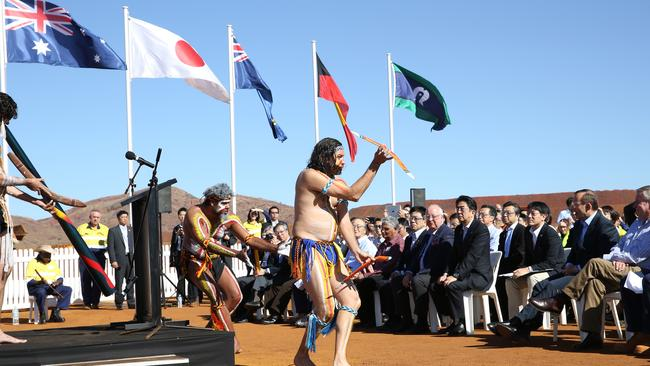 Enjoying a dance ... Prime Minister Tony Abbott and the Japanese Prime Minister Shinzo Abe at a ceremony with traditional dancers Olman Walley, Theo Kearing and John Walley. Picture: Gary Ramage