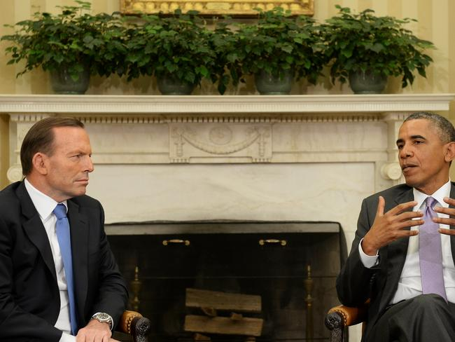 Australia PM Tony Abbott meets with President Obama in the Oval Office of The White House. Picture: Jake Nowakowski