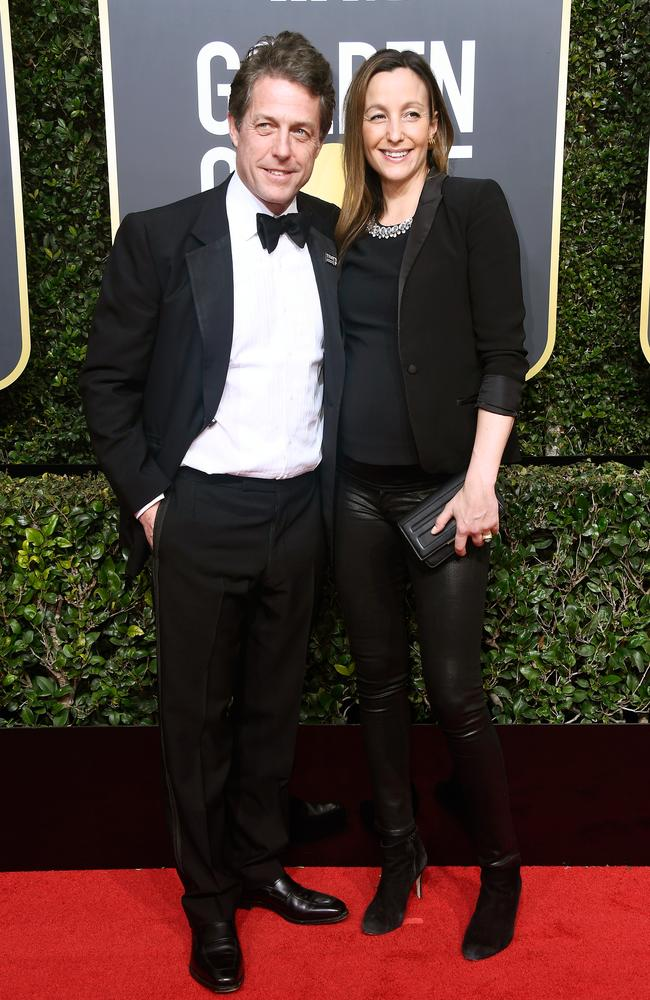 Hugh Grant and Anna Eberstein at the Golden Globes earlier this month. Picture: Getty