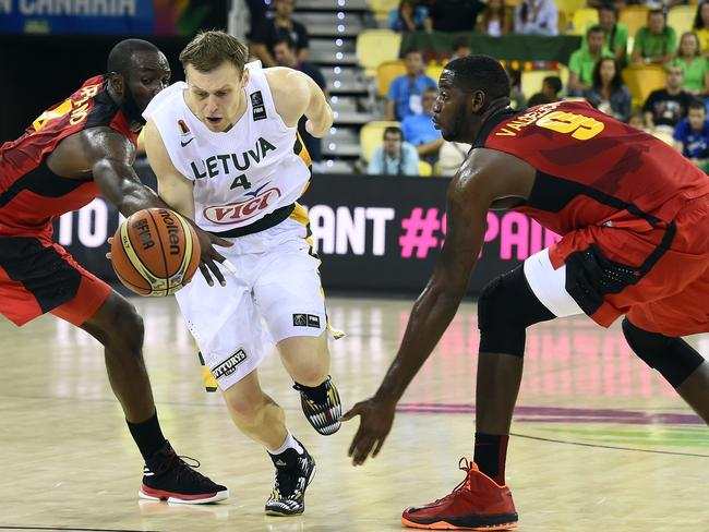 Lithuanian forward Martynas Pocius drives through Angola's defence.