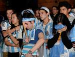 Grim reality sets in for Argentinian fans at La Boca restaurant, as the World Cup slips from their team's hands. The misery shows on the face of drummer Daniel Ryan and fellow fan Eli Barbalace. Picture: Noelle Bobrige