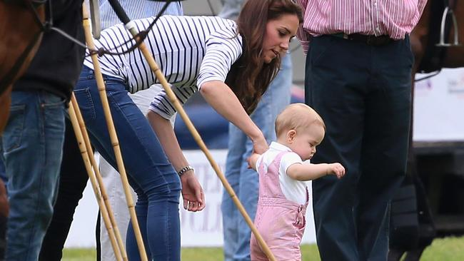 Prince George goes walkabout with mum at his side. Catherine, Duchess of Cambridge and Prince George of Cambridge attend the Royal Charity Polo at Cirencester Park Polo Club.