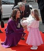 <p>Crown Princess Mary of Denmark (C) receives a bouquet of flowers from Isabella Riccio, age four, upon her arrival to officially open the Victor Chang Lowy Packer building of the St Vincent's Centre for Applied Medical Rearch in Sydney. AFP PHOTO</p>