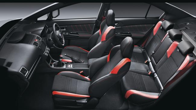 Refined: the red seat belts and stitched leather are nice touches.