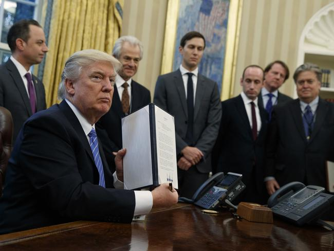 President Donald Trump shows off a signed executive order to reinstitute a policy barring any recipient of US assistance from performing or promoting abortions abroad. Picture: Evan Vucci/AP Photo