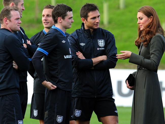 Catherine the Duchess of Cambridge speaks with England footballers Adam Johnson and Frank Lampard.