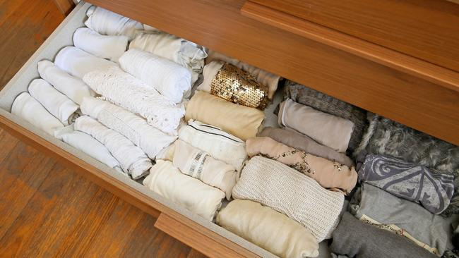 Also, Marie Kondo says you should store your T-shirts like this. And doesn't an organise wardrobe make you happy? Picture: Troy Snook