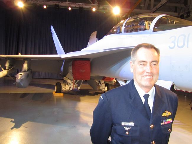 "'Dog Biscuit': Recently retired chief of the air force Air Marshal Geoff Brown with the RAAF's first EA-18G ""Growler"" electronic attack aircraft at the Boeing plant in St Louis."