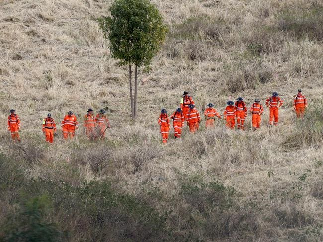 SES workers search for evidence close to where the body of Jayde Kendall was found. Picture: Jono Searle.