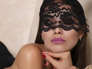 beautiful glamour model in bunny's mask lying on the divan