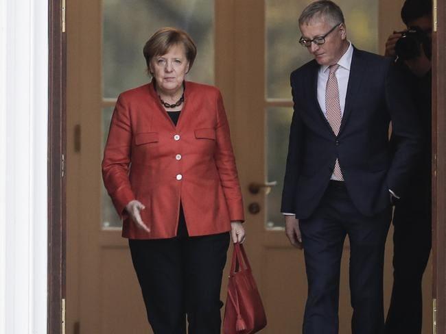 German Chancellor Angela Merkel and German President Frank-Walter Steinmeier. Picture: AP.