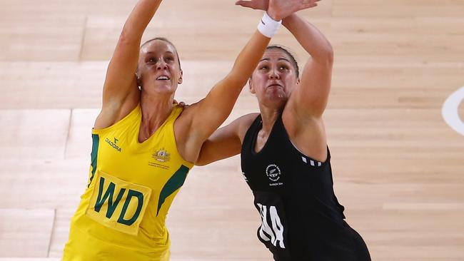 Renae Hallinan fights for the ball with New Zealand's Liana Leota.