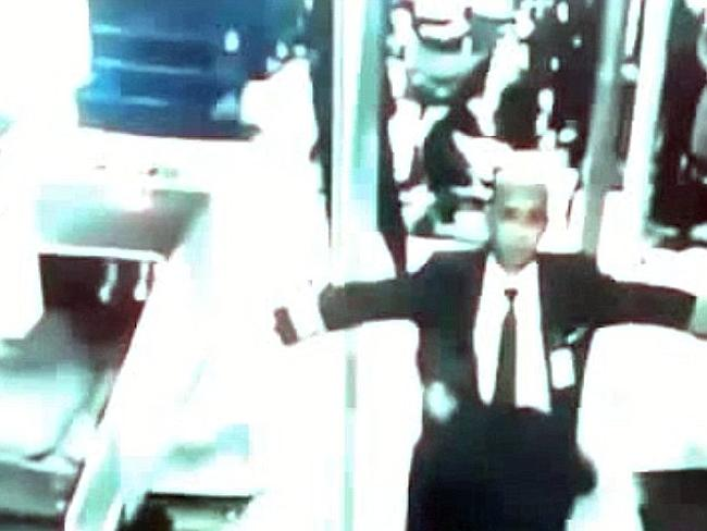CCTV footage captures Captain Zaharie Ahmad Shah, pilot of the Boeing 777 flight, being frisked while walking through security at Kuala Lumpar International Airport.