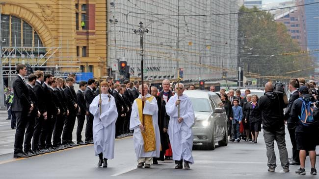 Family members walk behind the hearse along Flinders St. Picture: Getty