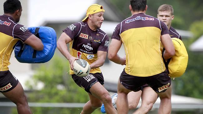 TRAINING THE HOUSE DOWN: Scott Prince runs the ball at a Broncos session at Red Hill. Picture: Jono Searle