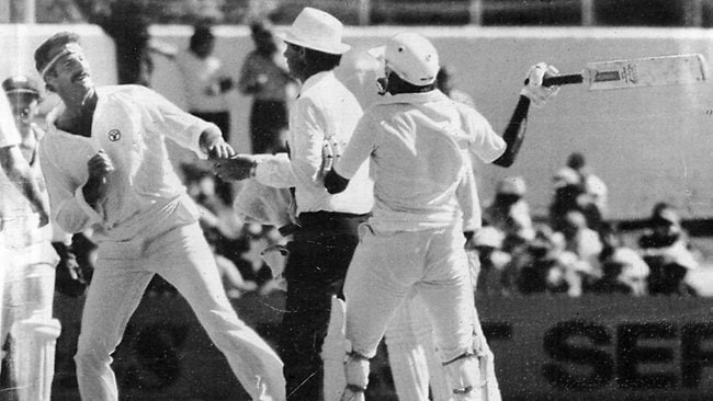 A fired-up Javed Miandad threatens to hit Dennis Lillee with his bat