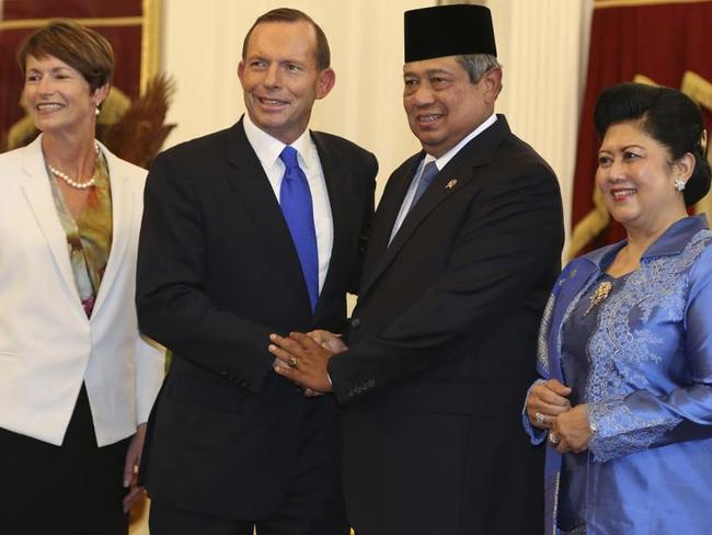 Bid to improve relations ... Prime Minister Tony Abbott, his wife Margie, with Indonesian President Susilo Bambang Yudhoyono, and his wife Ani at Merdeka Palace in Jakarta, Indonesia in September last year.