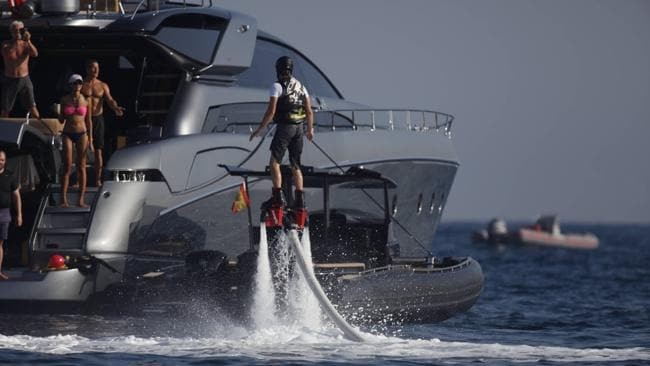 Leo shows off his skills to the rest of the crew on Vladislav Doronin's yacht. Picture: Splash News