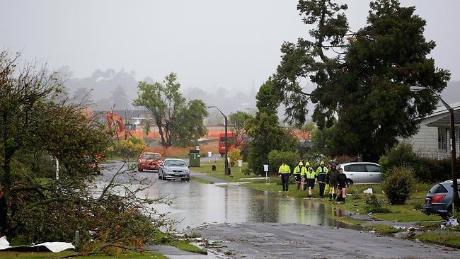 Emergency services in the Auckland suburb of Hobsonville in the aftermath of a tornado. Picture: Getty