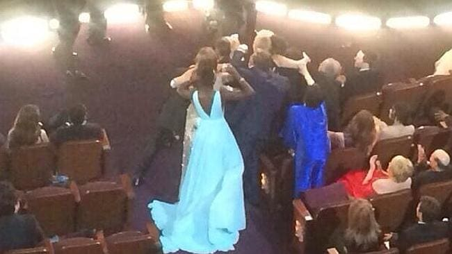 Liza Minnelli (in blue) missing out on Ellen's selfie picture at the Oscars