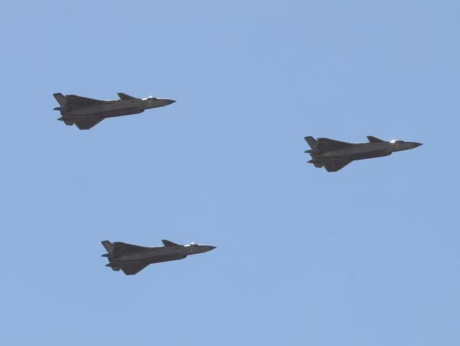 A flight Chinese J-20 stealth fighter jets fly past during a military parade at the Zhurihe training base in China's northern Inner Mongolia region on July 30, 2017. Picture: AFP