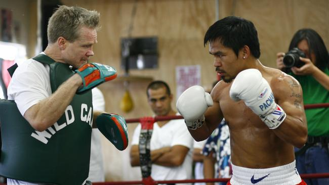 Manny Pacquiao spars with trainer Freddie Roach.
