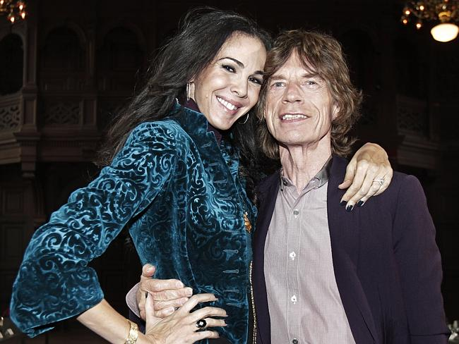 In happier times ... Mick Jagger, right, with designer L'Wren Scott in New York. Picture: Richard Drew