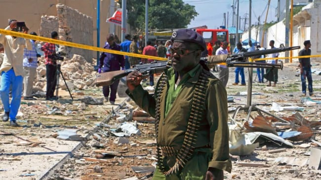 A Somali soldier at the site of a suicide bombing earlier this year