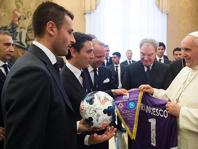 Pope Francis receives a ball, pennant and shirt from Fiorentina coach Vincenzo Montella (second left). Picture: L'Osservatore Romano