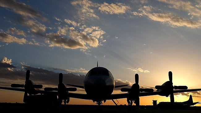 A Royal Australian Air Force P3 Orion is seen on the tarmac after returning to Pearce air