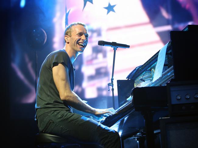 Having fun ... Chris Martin from British band Coldplay hold a concert at The Enmore Theatre as part of their Sydney 2014 tour. Picture: Richard Dobson
