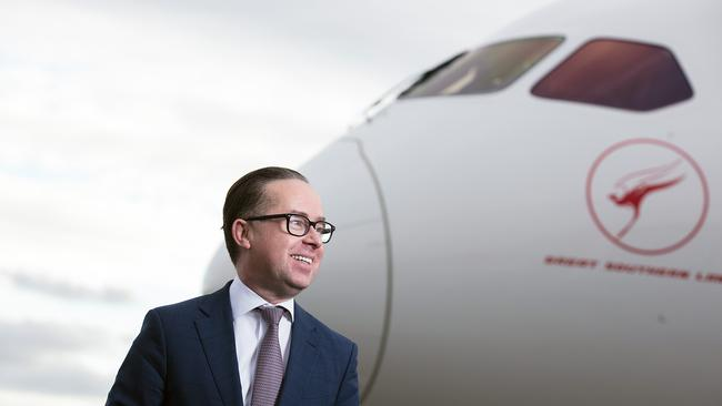 Qantas CEO Alan Joyce posing for a photograph with the new Qantas 787-9 Dreamliner. (AAP Image/Qantas, Brent Winstone)