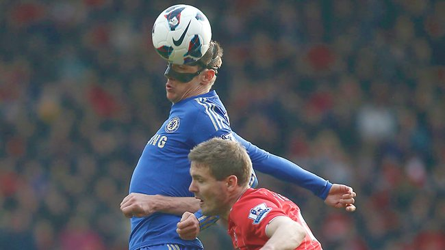 Chelsea's Fernando Torres, left, competes with Southampton's Jos Hooiveld during the English Premier League match at St Mary's stadium. Southampton won 2-1. Picture: Sang Tan