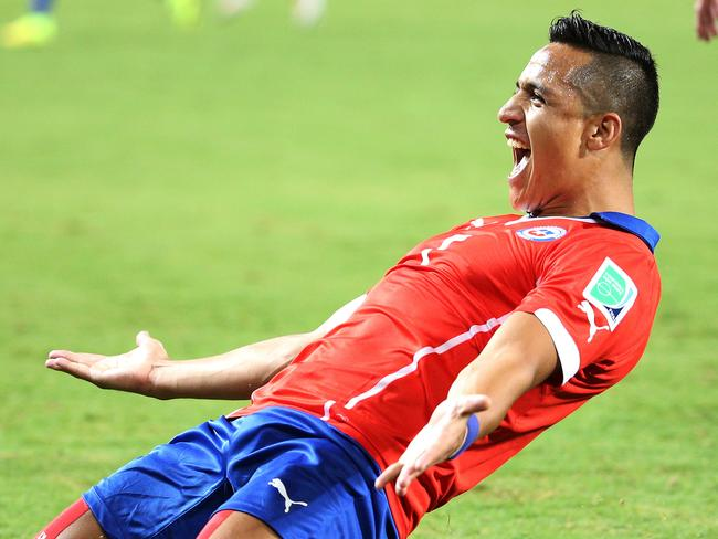 Alexis Sanchez of Chile scores the opener against Australia in their World Cup clash.