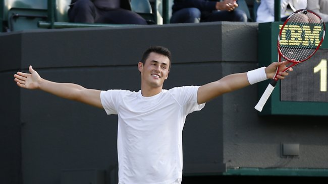 Bernard Tomic of Australia reacts after winning the second set against Tomas Berdych of the Czech Republic during their Men's singles match at the All England Lawn Tennis Championships in Wimbledon.