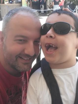 Anthony Khoury and his son Dominic, was left with a brain injury after a cardiac arrest.