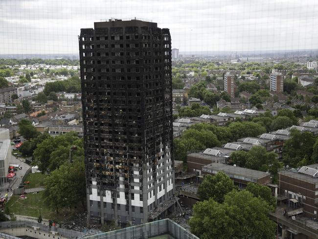 After the blaze was tamed, London firefighters combed through the burnt-out public housing tower in a grim search for missing people. Image: AP/Matt Dunham