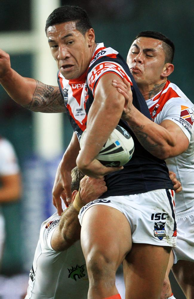 Tautau Moga tackled while playing for the Roosters.