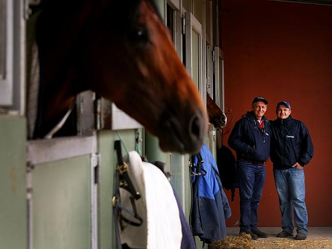Peter Snowden with son Paul at Flemington during last year's spring carnival. Picture: Co