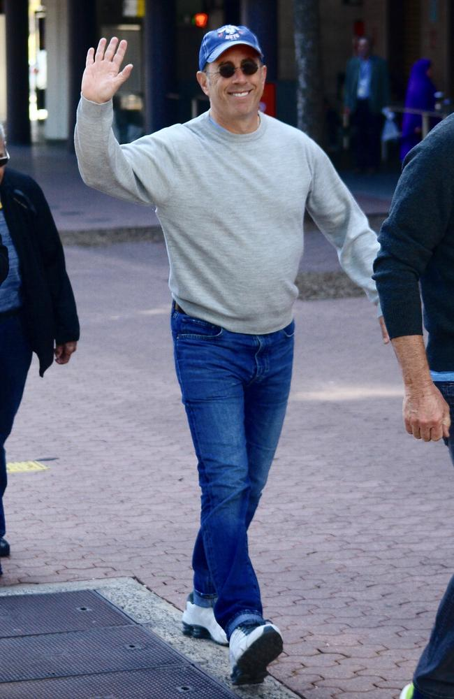 Wonder if those white sneakers were cleaned at the Mom and Pop Store? Jerry Seinfeld goes for stroll with a friend around Olympic Park. Picture: Mega