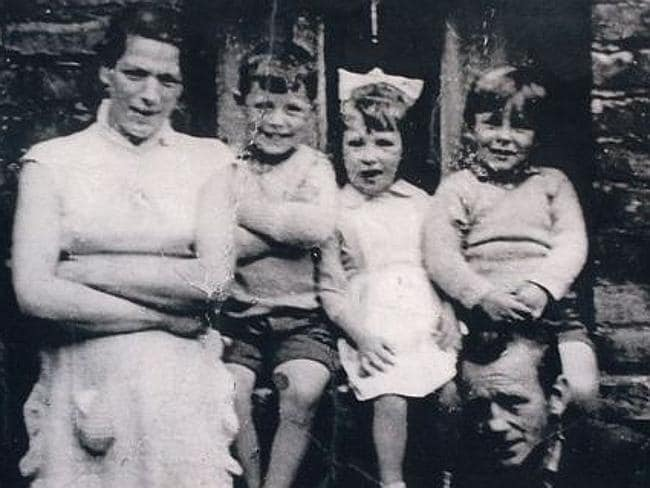 Victim ... Jean McConville (left) with three of her children before she vanished in 1972.