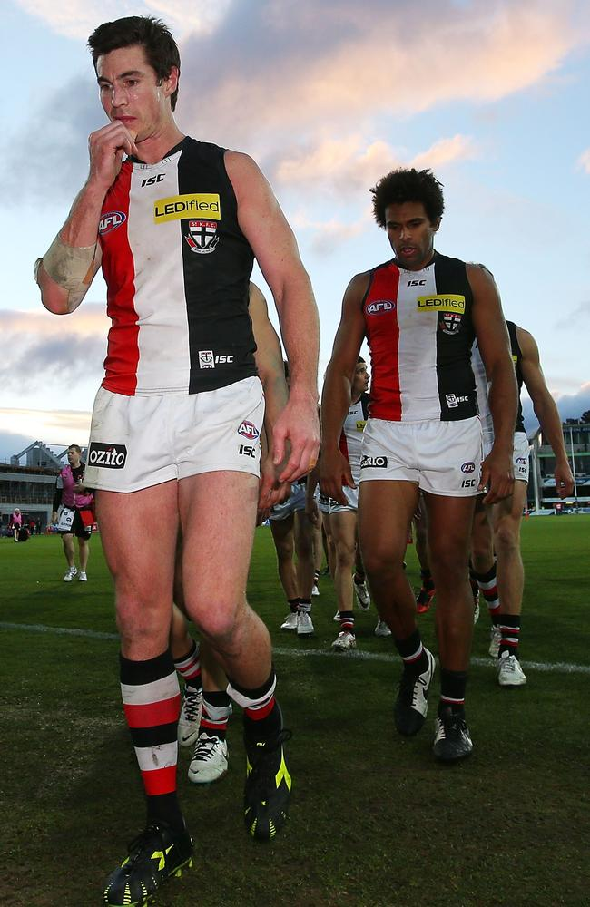 Lenny Hayes leads the Saints off the ground. Picture: Getty