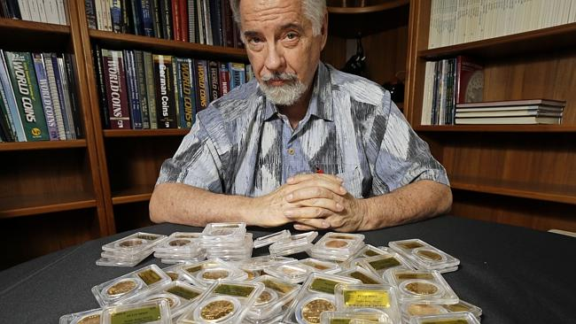 David Hall, co-founder of Professional Coin Grading Service, with some of the 1,427 mint-condition coins, which have been linked to a 1900 heist.