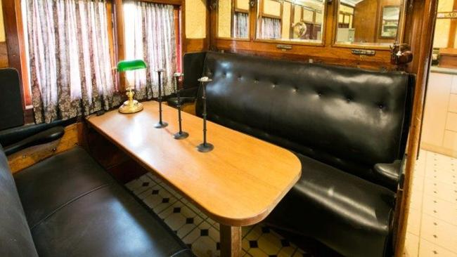 The old train seats are used for the dining table. Picture: realestate.com.au
